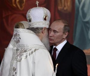 Russian PM Putin kisses Patriarch of Moscow and All Russia Kirill during an Orthodox Easter service in the Christ the Saviour Cathedral in Moscow